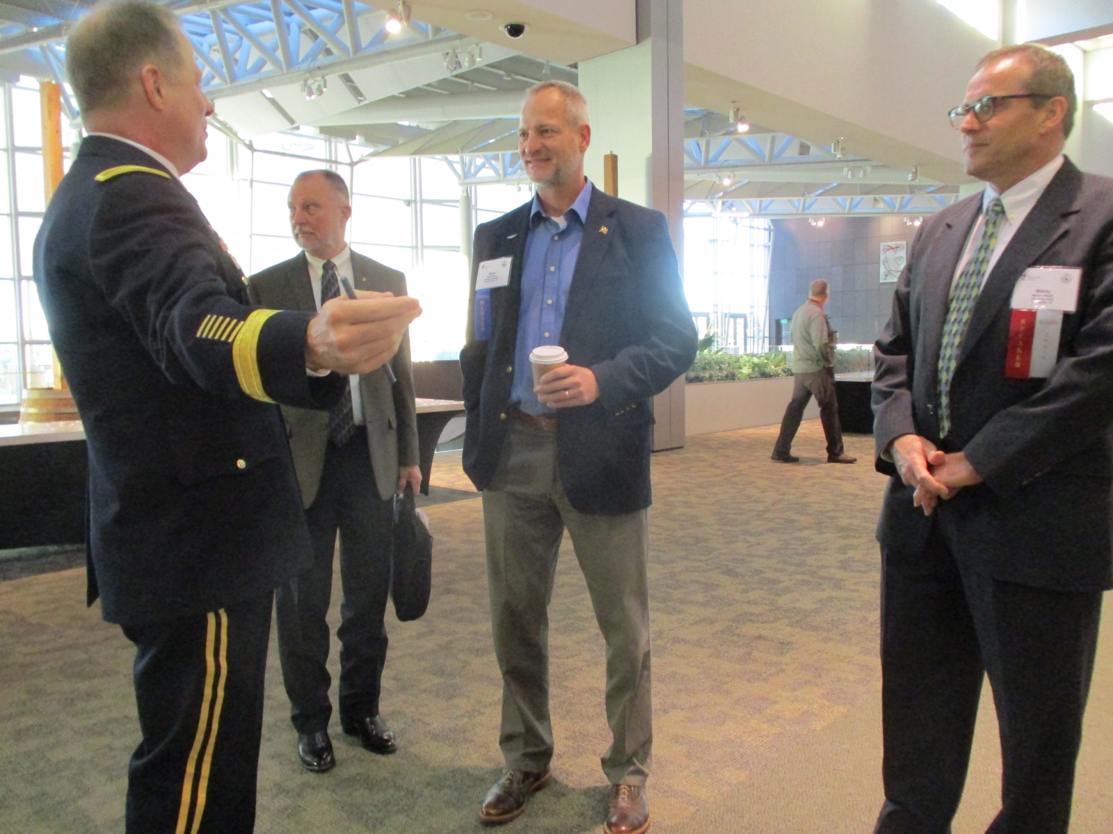 From left - Marty Walsh (ADD-Fort Eustis), David Meyer (Boeing) and Dan Toy (Rockwell Collins) greet our keynote speaker.